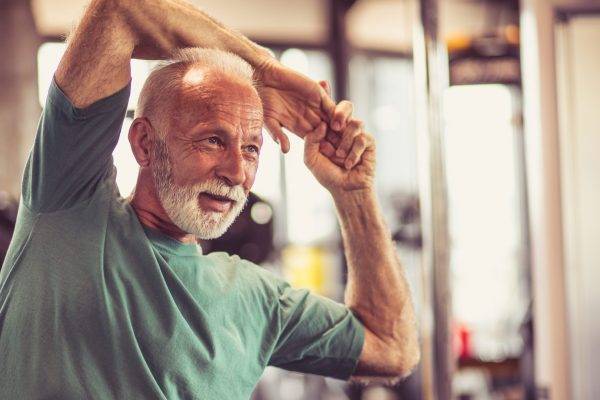 stock-photo-stretch-your-muscles-before-all-exercises-senior-man-at-gym-working-exercise-close-up-1233992005